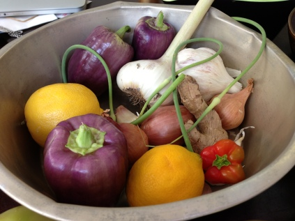 What a beautiful collection of aromatics: Purple peppers*, garlic cloves*, garlic scapes*, Meyer lemons, ginger, and a red bell pepper* from my patio (* Local)
