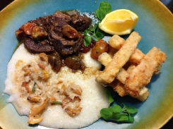 Braised shoulder steak, grits with chanterelle cream sauce, green tomato and eggplant fries